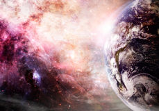 Creation of Earth. Photo based image of Earth and galaxy. Elements of this images supplied by NASA Royalty Free Stock Photo