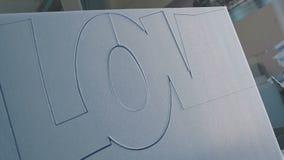 Creation of a volumetric inscription logotype . stock footage