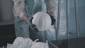 Creation of volumetric scenery from foam plastic. Close up: Cutting plastic foam. Automatic cutting of expanded polystyrene foam plastic. The process of stock video footage