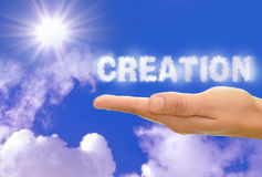 Creation. Written with clouds with bright sun rays Stock Photos