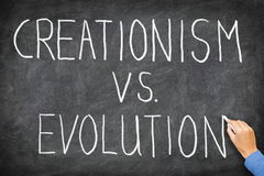 creationismevolution vs royaltyfria bilder