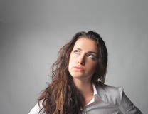Creative. Young businesswoman thinking of something Royalty Free Stock Photos