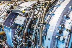 Aviation turbojet engine equipment. Creative abstract aviation industry technology concept: macro view of the airliner turbojet turbine engine equipment with Royalty Free Stock Photography