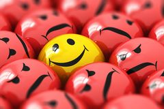 Single happy yellow smiley among red angry ones. Creative abstract 3D render illustration of the macro view of single happy yellow smiley among red angry ones Stock Photography