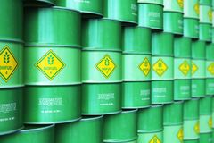 Group of rows of green stacked biofuel drums in storage warehous. Creative abstract ecology, alternative sustainable energy and environment protection saving Stock Photos