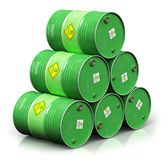 Group of green biofuel drums isolated on white background. Creative abstract ecology, alternative sustainable energy and environment protection saving business Stock Photo