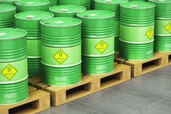 Group of green biofuel drums on shipping pallets in the storage. Creative abstract ecology, alternative sustainable energy and environment protection saving Royalty Free Stock Photo