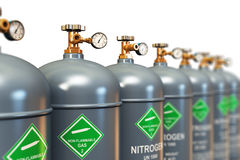 Row of liquefied nitrogen industrial gas containers. Creative abstract fuel industry manufacturing business concept: 3D render illustration of the group of gray Stock Photo