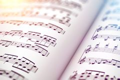 Score sheet music book. Creative abstract musical concept background: 3D render illustration of the macro view of white score sheet music with notes with Stock Photo