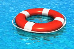 Lifesaver belt in the blue water Royalty Free Stock Photos