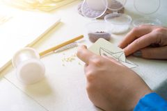 Creative activity. Girl is engaged in creative activity in the workshop stock images