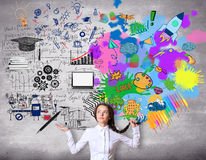 Creative and analytical thinking concept. Confused girl with colorful sketch on concrete background Stock Photography