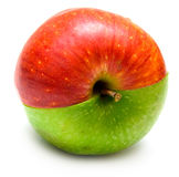 Creative apple. The creative apple combined from two half of red and green color Royalty Free Stock Photos