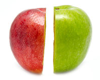 The creative apple combined from two half of red and green Royalty Free Stock Image