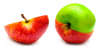 Creative apple and half. The creative apple combined from two half of red and green color and half of red apple on white Royalty Free Stock Photo