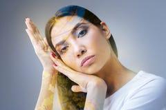 Beautiful brunette woman enjoying her creation Stock Image
