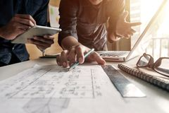 Creative architect projecting on the big drawings royalty free stock photos