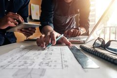 Creative architect projecting on the big drawings stock photos