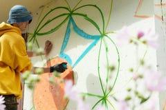 Creative art - Image of guy painting graffiti Stock Photo
