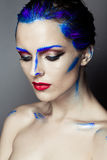 Creative art makeup of a young girl with blue eyes Royalty Free Stock Image
