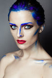 Creative art makeup of a young girl with blue eyes Stock Image