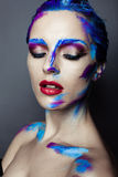 Creative art makeup of a young girl with blue eyes Royalty Free Stock Photography