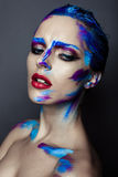 Creative art makeup of a young girl with blue eyes Stock Photos