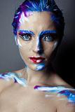 Creative art makeup of a young girl with blue eyes Stock Photo