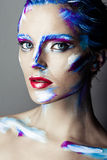 Creative art makeup of a young girl with blue eyes Royalty Free Stock Images
