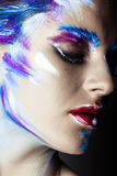 Creative art makeup of a young girl with blue eyes Stock Photography