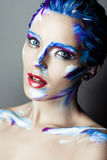 Creative art makeup of a young girl with blue eyes Royalty Free Stock Photo