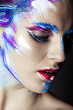 Creative art makeup of a young girl with blue eyes Stock Images