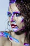 Creative art makeup of a young girl with blue eyes. Stock Photos