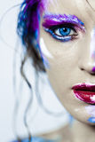Creative art makeup of a young girl with blue eyes. Stock Photos