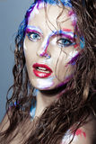 Creative art makeup of a young girl with blue eyes. Royalty Free Stock Image