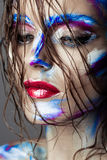 Creative art makeup of a young girl with blue eyes. Royalty Free Stock Photography
