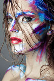 Creative art makeup of a young girl with blue eyes. Stock Photo