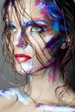 Creative art makeup of a young girl with blue eyes. Royalty Free Stock Photos