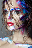 Creative art makeup of a young girl with blue eyes. Stock Images