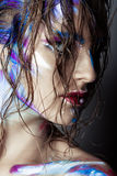Creative art makeup of a young girl with blue eyes. Royalty Free Stock Photo