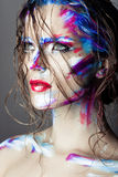 Creative art makeup of a young girl with blue eyes. Royalty Free Stock Images