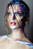 Creative art makeup of a young girl with blue eyes. Stock Photography