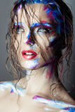 Creative art makeup of a young girl with blue eyes. Stock Image