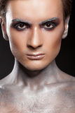 Creative artistic make up on a man Stock Photos