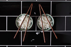 Creative artistic shapes using bowl of rice and chopsticks Royalty Free Stock Images