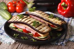Creative aubergine sandwich close-up on a plate. Royalty Free Stock Photo