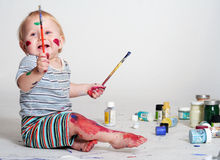 Creative Baby. A cute baby playing with paints Royalty Free Stock Photos