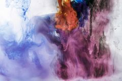 creative background with blue and violet flowing paint in water royalty free stock photography
