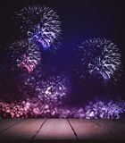 Creative firework background. Creative background with empty wooden surface and fireworks. Mock up Stock Photos