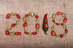 2018 , creative background with hot peppers Royalty Free Stock Images